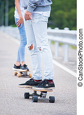 Young couple having fun with skateboards
