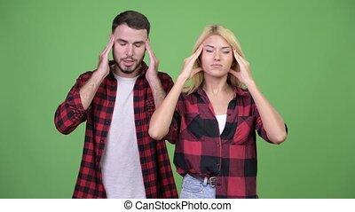 Young couple having headache together