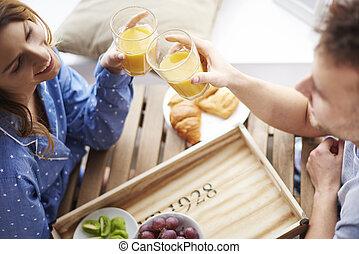 Young couple having healthy breakfast