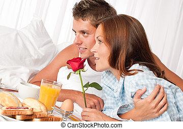 Young couple having luxury hotel breakfast