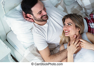 Young couple having romantic time in bedroom