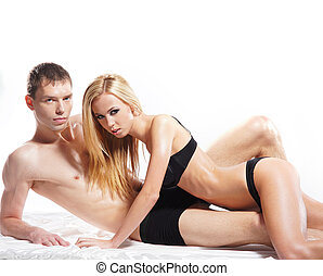 Young couple having sex over white background