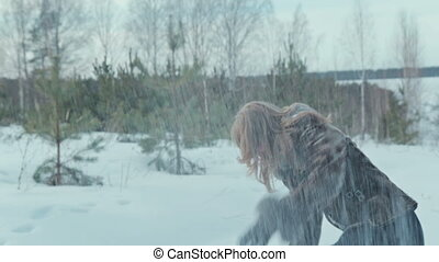 Young couple having snowball fight and kiss - Young couple...