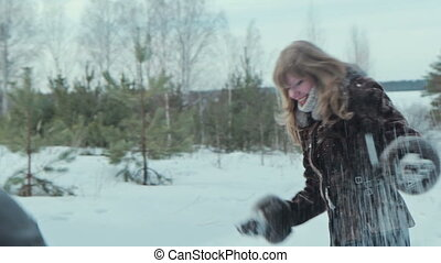Young couple having snowball fight,HD
