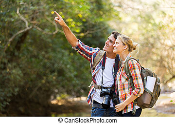 young couple hikers in mountain