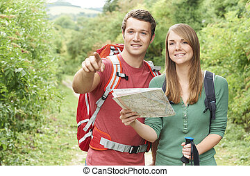 Young Couple Hiking In Countryside