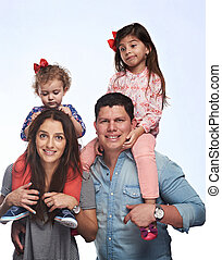 Young couple hold kids on shoulder