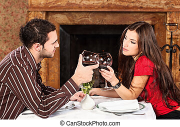 couple holding glasses of wine