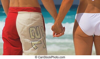 young couple holding hands close