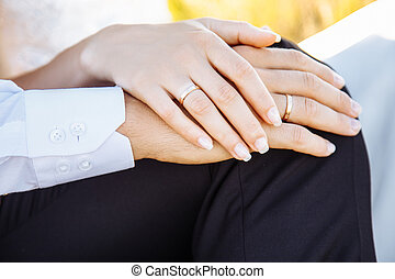 Young couple holding hands in the field.
