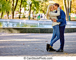 Young couple hugging and flirting in  park.