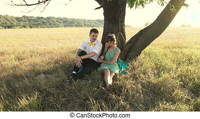 Young couple hugging below the tree