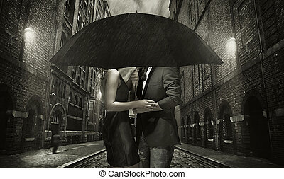 Young couple hugging in the rain