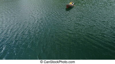 Young Couple In A Boat On The Background Of A Lake.