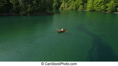 Young Couple In A Boat On The Background Of A Lake. - Young ...