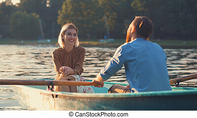 Young couple in a boat outdoors