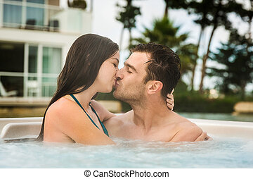 Young couple in a jacuzzi