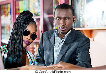 Young couple in a shop selling jewelry.