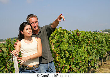 Young couple in a vineyard