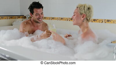 Young Couple In Bath Together Drink Champagne Talking, Man...