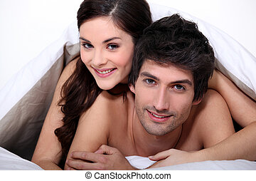 Young couple in bed together