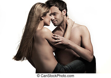 Young couple in blue jeans on white background
