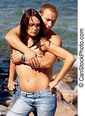 Young couple in blue jeans