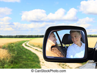 Young couple in car at countryside