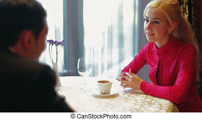 Young couple in coffee shop - Young couple talking in a...