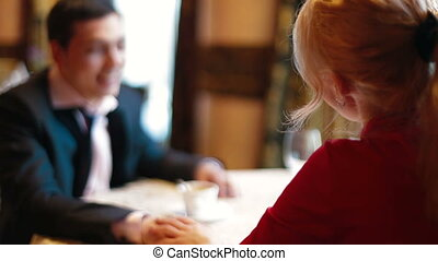 Young couple in coffee shop