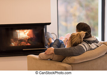 Young couple in front of fireplace - Young romantic couple...