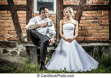 Young couple in front of old vintage house