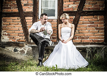 Young couple in front of vintage house