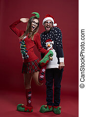 Young couple in funny Christmas clothes