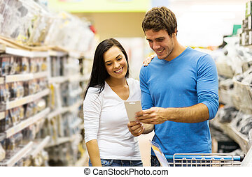 young couple in hardware store