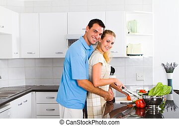 young couple in home kitchen