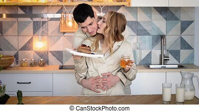 young couple in kitchen before a Breakfast - Happy cheerful...