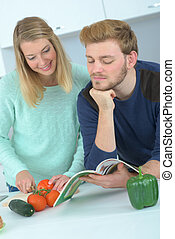 young couple in kitchen preparing lunch