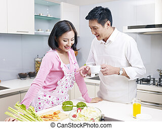 More stock photos from this artistSee All. young couple in kitchen. young  asian couple talking ...