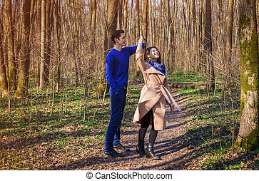 Young couple in love dancing in the forest