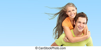 Young couple in love - Happy smiling couple in love. Over...