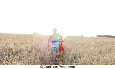 Young couple in love have romance and fun at wheat field in summer