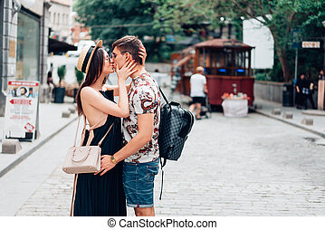 Young couple in love, hugging on the street.