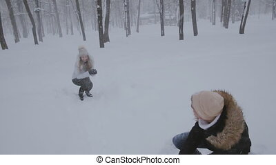 young couple in love in the snow-covered forest