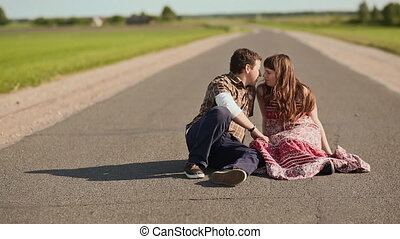 Young couple in love kissing on the path