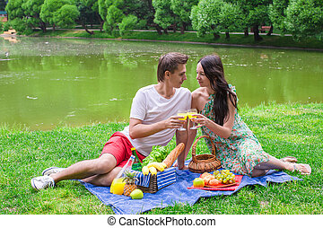 Young couple in love on a picnic outdoors