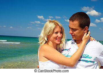 young couple in love on beach