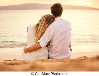 Young couple in love on the beach sunset - Young couple in...
