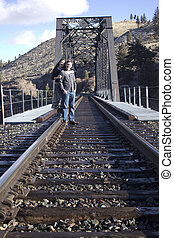 young couple in love on the train tracks