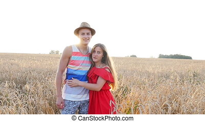 Young couple in love outdoor at field